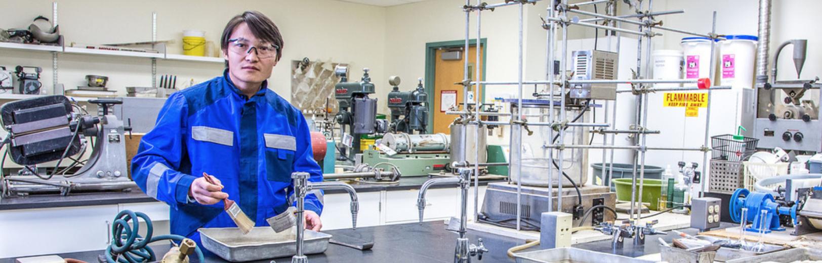 UAF graduate student Purevbaatar Narantsetseg works with samples of rare earth minerals
