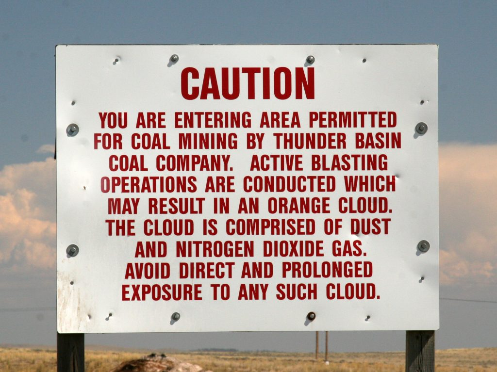 An image of a warning sign outside of a mining area.